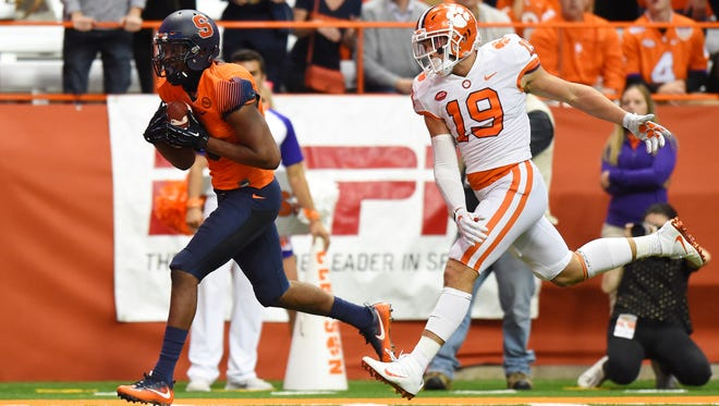 Syracuse Orange wide receiver Steve Ishmael (8) runs with the ball after a catch for a touchdown in front of Clemson Tigers safety Tanner Muse (19) during the third quarter at the Carrier Dome.