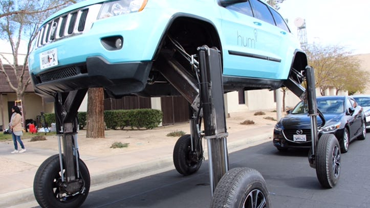 This elevating car can drive over traffic