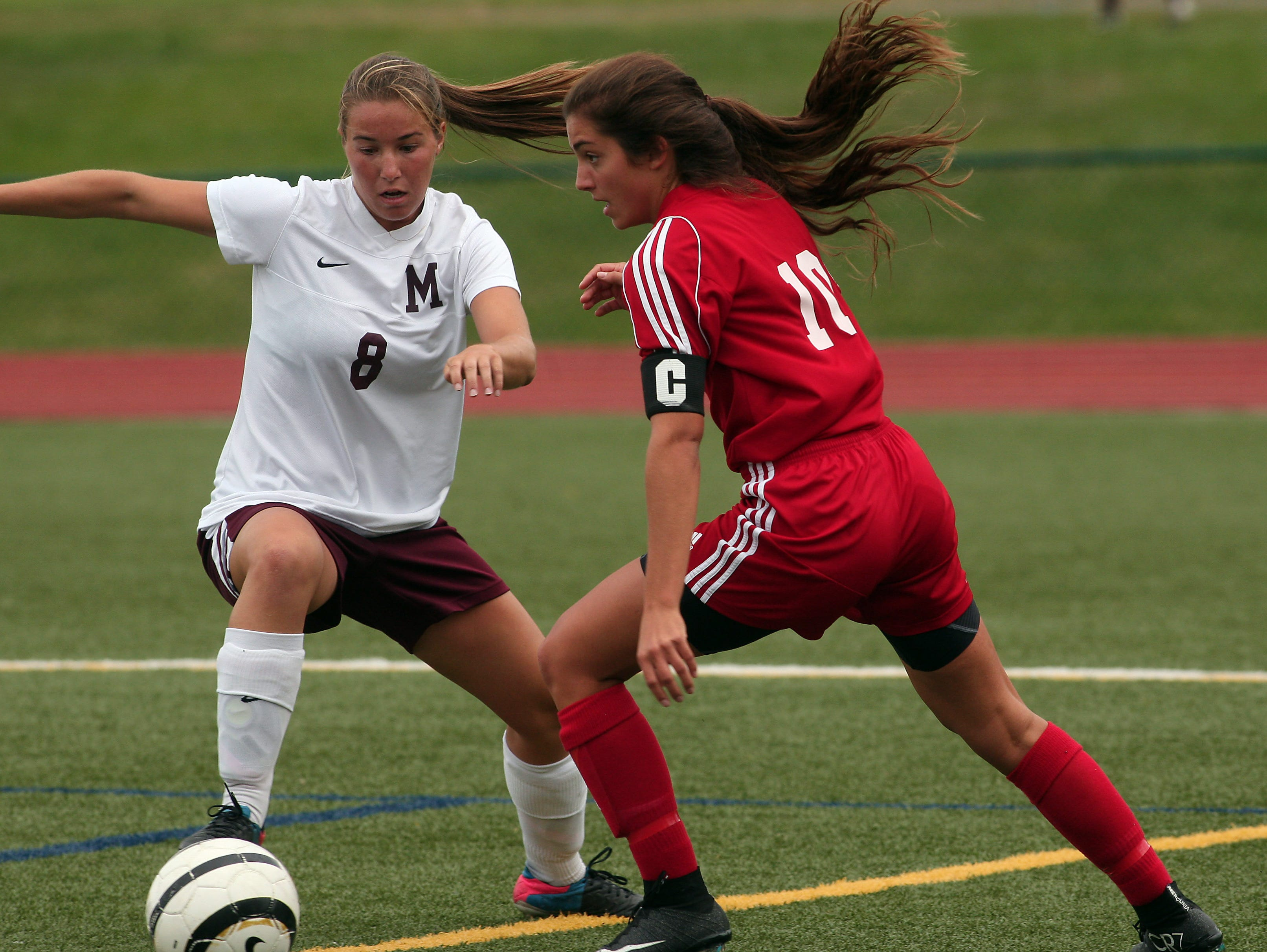 Madison's Megan Dyer, l, and Whippany Park's Gina DelloRusso battle for the ball during their girls soccer matchup. September 22, 2015, Madison, NJ.