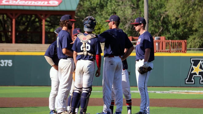 Sluggers head coach Jake Jones approaches the mound on Tuesday, June 23 against Great Bend at Wichita State University's Eck Stadium. The Sluggers are on a roll, winning six straight heading into this week's games.