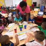 Lincoln Park Primary School Kindergarten Teacher Latria Sykes assists her students with a an Science Technology Engineering and Math exercise during the school wide STEM program kick-off Wednesday morning Sept. 16, 2015.