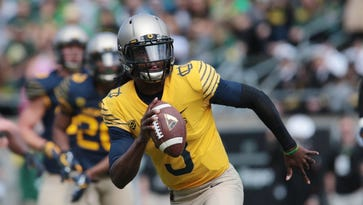 Freshman early enrollee Terry Wilson is in a three-way competition to be Oregon's starting quarterback this fall.