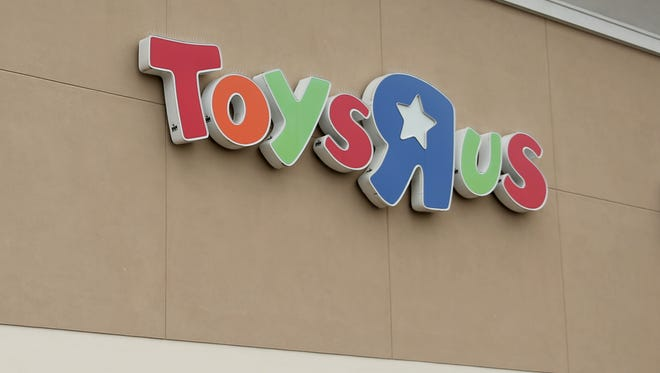 Customers exit Toys R Us and Babies R Us on Lancaster Dr. NE in Salem on Thursday, March 15, 2018.