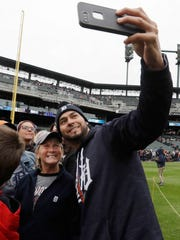 Detroit Tigers pitcher Anibal Sanchez takes a selfie with LuAnn Sheptow of Erie, Pa., before a baseball game against the Chicago White Sox, Saturday, April 29, 2017, in Detroit. Members of the Tigers met with fans before the game during the team's photo day.