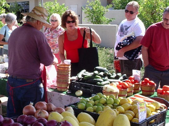 Shoppers smile and shop at Trilogy at Vistancia's farmers' market.