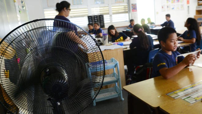 Fans circulate air in a fifth-grade classroom at Ordot-Chalan Pago Elementary School in September 2013.