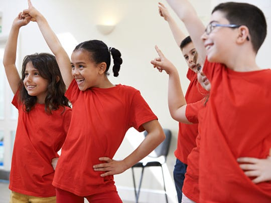 A kid's dance party is one way to entertain children indoors during rainy and winter weather.