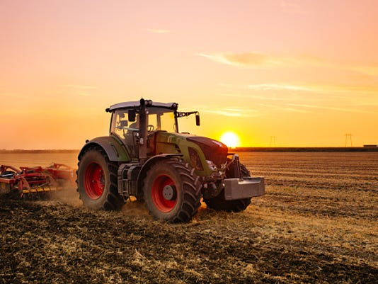 636117138293573096-tractor-plowing.jpg