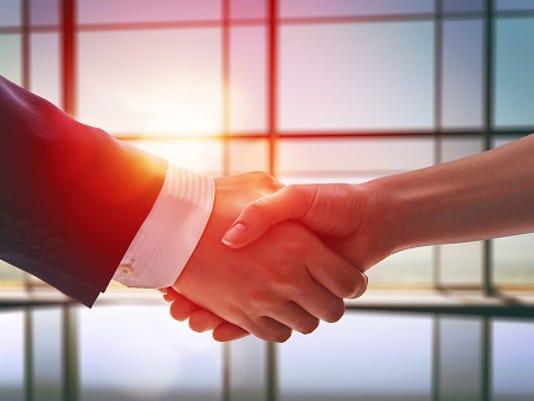 636119830709542510-business-handshake.jpg