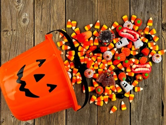 Halloween Jack o Lantern pail with spilling candy over