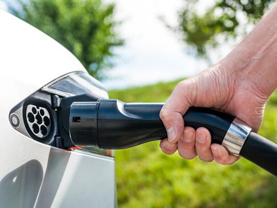 An electric vehicle. The bill approved Friday would impose a $200 fee on electric vehicles and a $125 fee on plug-in hybrids.