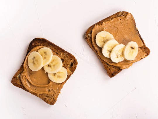 Peanut butter sandwiches on white kitchen table