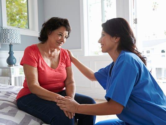 Nurse speaking to patient