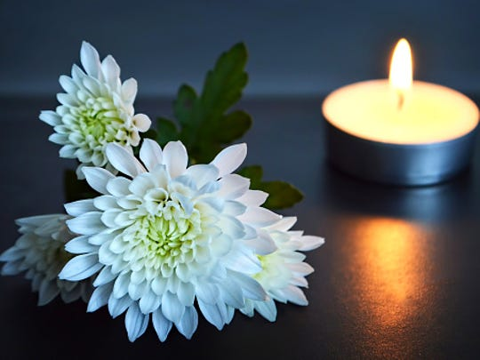 Candle and white flowers