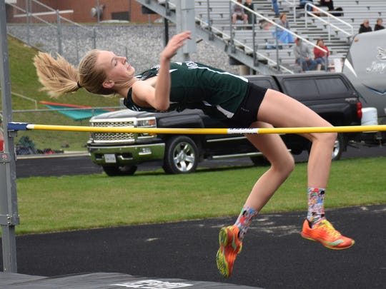 Wilson Memorial's Paige Miller clears the bar during the girls high jump competition in a Shenandoah District meet at East Rockingham High School in Elkton, Va., on Wednesday, April 5, 2017.