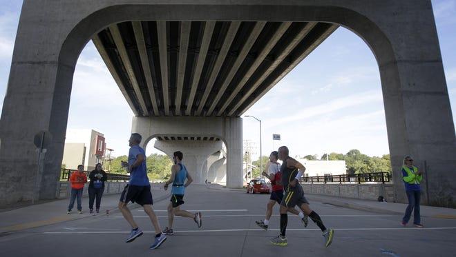 Marathon participants run beneath the College Avenue bridge during last year's Community First Fox Cities Marathon.