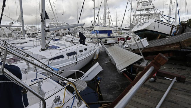 Boats are piled on each other in the marina following the effects of Hurricane Isaias in Southport, N.C., Tuesday, Aug. 4, 2020.  Hurricane season has already been busy this year, but forecasters say it should get even nastier soon. The National Oceanic and Atmospheric Administration Thursday, Aug. 6 increased its forecast for the number of named storms, hurricanes and major hurricanes this year to far above normal.