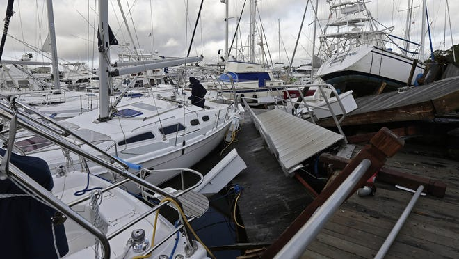 FILE - Boats are piled on each other in the marina following the effects of Hurricane Isaias in Southport, N.C., Tuesday, Aug. 4, 2020.  Hurricane season has already been busy this year, but forecasters say it should get even nastier soon. The National Oceanic and Atmospheric Administration Thursday, Aug. 6 increased its forecast for the number of named storms, hurricanes and major hurricanes this year to far above normal.