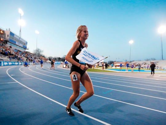 Karissa Schweizer of Missouri runs a victory lap after