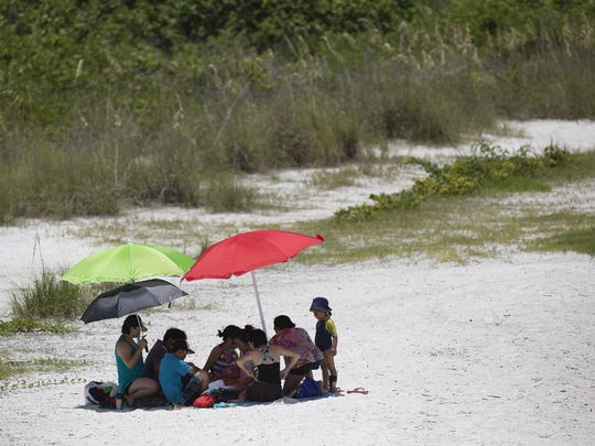 A family enjoys the north end Lovers Key on Tuesday, June 23, 2015.