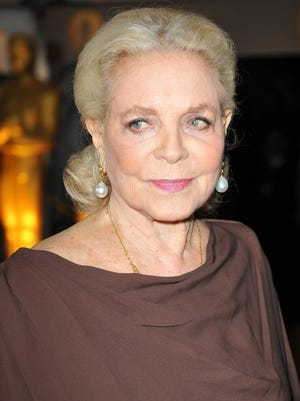 This November 14, 2009 file photo shows US actress Lauren Bacall arriving for the 2009 Governors Awards at the Grand Ballroom at Hollywood & Highland Center in Hollywood, California. Legendary American actress Lauren Bacall, whose smoldering gaze and deep, husky voice made her a Hollywood icon, has died, the Humphrey Bogart Estate confirmed August 12, 2014. ROBYN BECK/AFP/Getty Images
