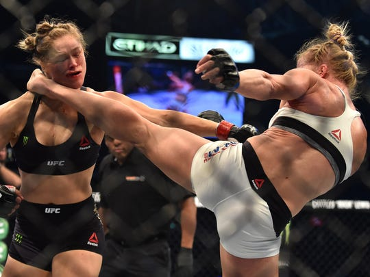 Holly Holm connects with the decisive head kick to KO Ronda Rousey at UFC 193.