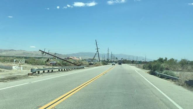 """An Aug. 6 storm that meteorologists described as a """"mini-tornado"""" downed more than 100 utility poles in Mecca, Thermal and Oasis."""
