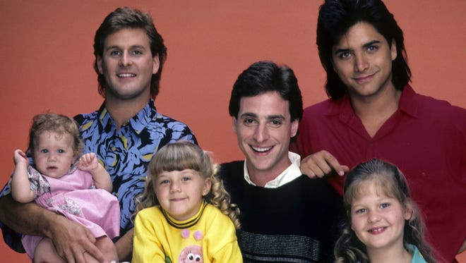 """The """"Full House"""" family from back in the day (from left): Mary-Kate or Ashley Olsen, Dave Coulier, Jodie Sweetin, Bob Saget, John Stamos and Candace Cameron."""