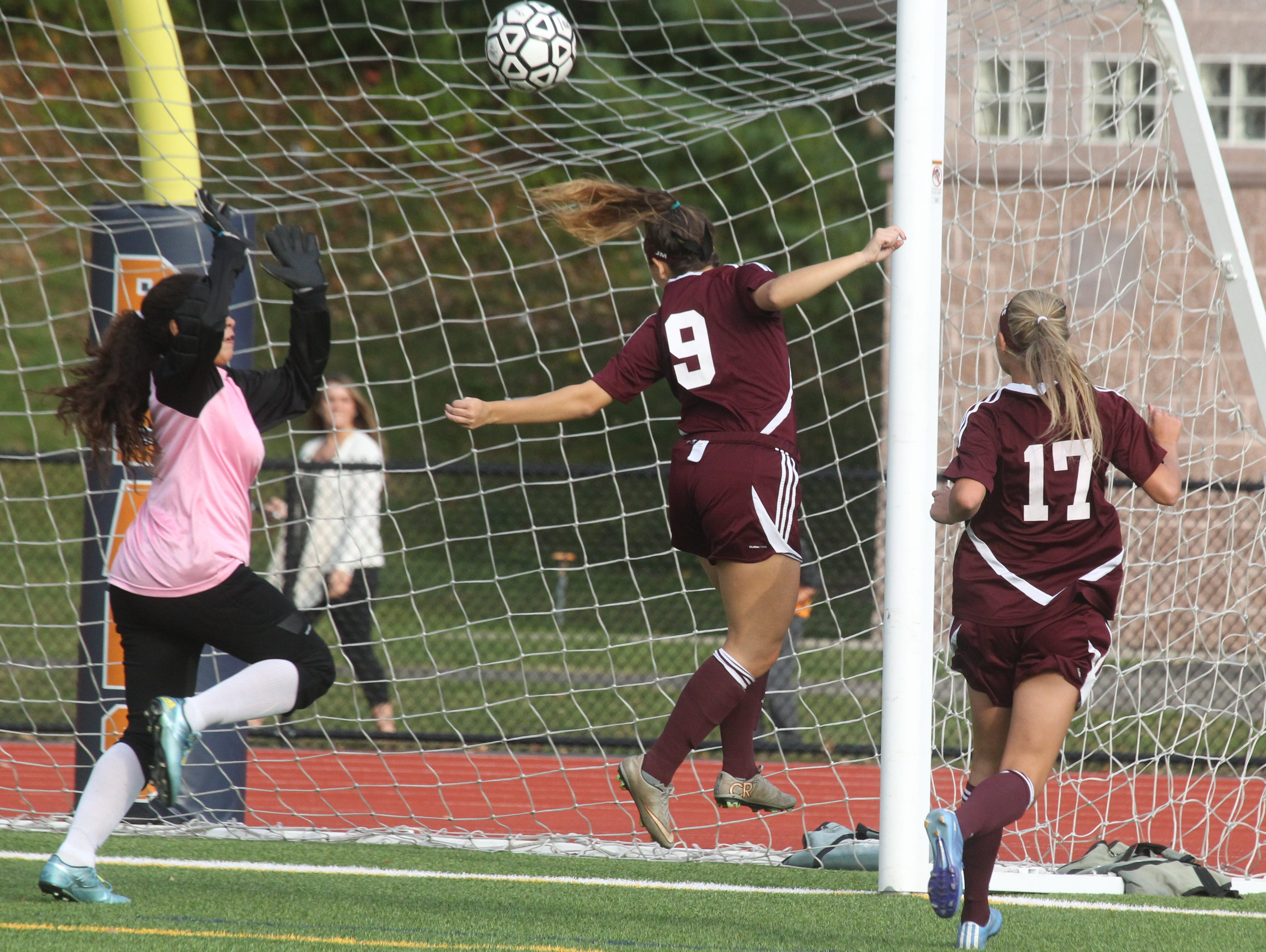 Albertus Magnus' Victoria McNamara scores past Briarcliff goalie Khassandra Muniz during their game at Briarcliff Oct. 8, 2015.