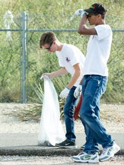 Mayors Top Teens MaLiam Hilaire, 16, right, and Thomas Wilkinson, 17, pick up trash on Saturday, October 14, 2017, along the Triviz Trail during the 23rd annual Toss No Mas campaign. The event was hosted by the city of Las Cruces Parks & Recreation Department's Keep Las Cruces Beautiful, along with New Mexico Clean and Beautiful.