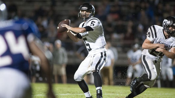 North Buncombe quarterback Chase Parker looks for a
