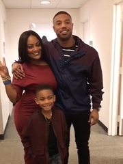 Adonis Wolfe with his mother, Jeniaya Coleman, and actor Michael B. Jordan.