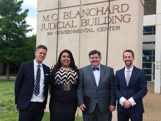 American Civil Liberties Union attorneys and client