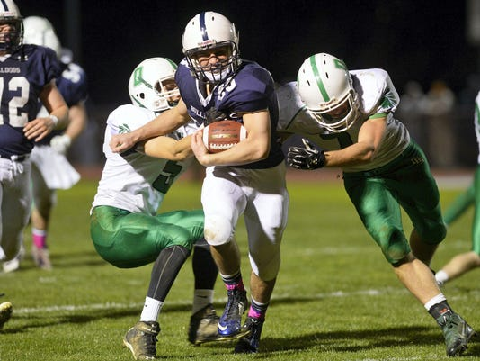 West York's Ryan Narber, center, drives against Donegal's Derek Mohr, left, and Connor Maxwell in the second half of a District 3 first-round playoff game last year at West York. Of the 12 Class AAA districts in Pennsylvania, District 3 has the largest with 40 schools. (FILE -- GAMETIMEPA.COM)