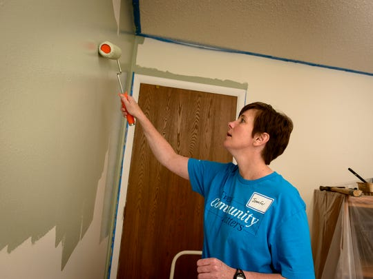 Jennifer Spencer of Farmington Hills put her painting experience to work during the Weekf Caring event by Mercedes-Benz Financial Services' employees.
