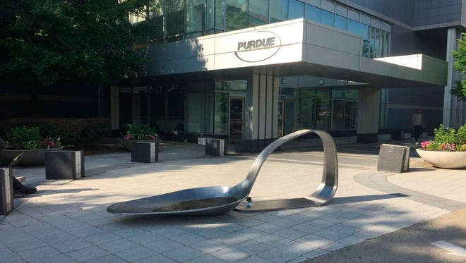 """An 800-pound sculpture, titled """"Purdue,"""" created by artist Domenic Esposito is displayed outside the Connecticut headquarters of drugmaker Purdue Pharma, Friday, June 22, 2018, in Stamford, Conn. The sculpture was inspired to create by Esposito's brother's battle with addiction. Several state and local governments are suing Purdue Pharma for allegedly using deceptive marketing to boost sales of its opioid painkiller OxyContin, blamed for opioid overdose deaths."""