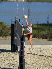 Jordan Benoit plays beach volleyball during a game at an elite youth camp in California.