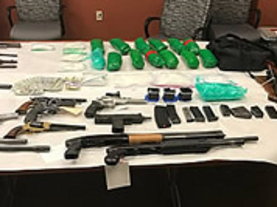 Guns, ammo, cash and meth packages were found during a police search of a Palm Springs stash house in December.