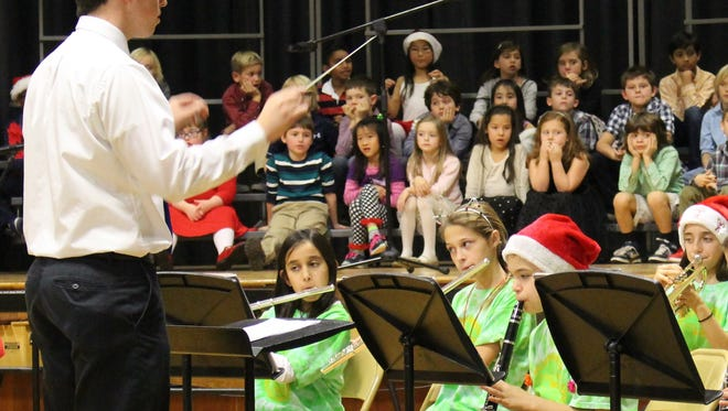 Instrumental Music teacher William Mellott conducts the Mt. Horeb Gold Band in classic holiday fare while 2nd graders await their turn to perform.