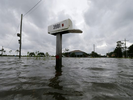 A mailbox sticks out of water during neighborhood flooding after Tropical Storm Cindy, now downgraded to Tropical Depression Cindy, in Big Lake, La., Thursday, June 22, 2017.