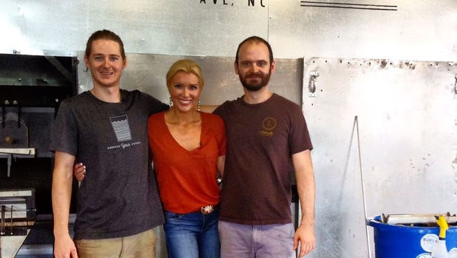 CMT host Allison DeMarcus with Lexington Glassworks owners Billy Guilford and Geoff Koslow.
