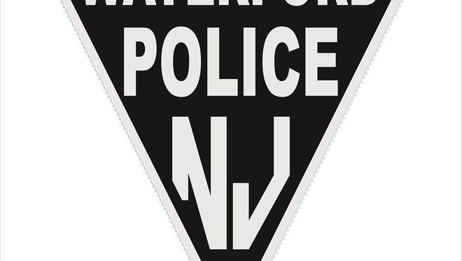 Waterford police are seeking a driver who backed into a patrol car, then fled.