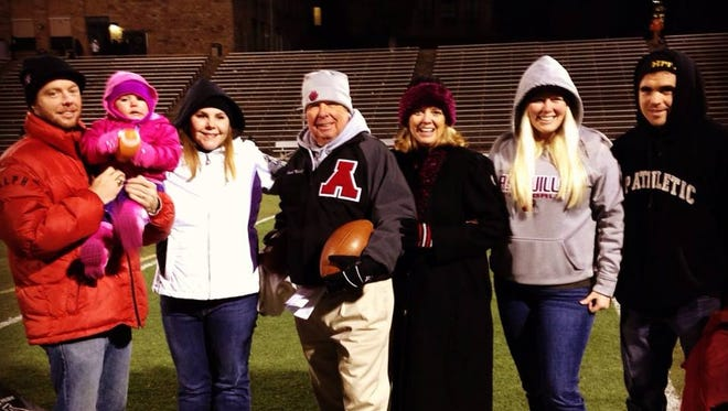 Asheville High assistant football coach Charlie Metcalf and his family.