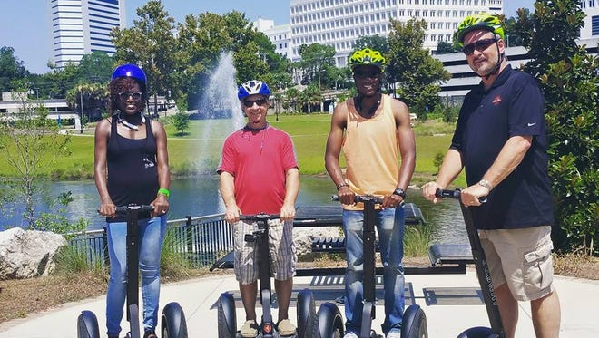 A group rides Segways in Cascades Park.