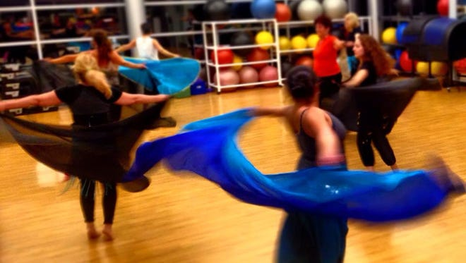 The belly dancing class at Parrish Health and Fitness Center in Titusville transports you to another place and time with colorful scarves, jingling skirts, and tantalizing dance moves.