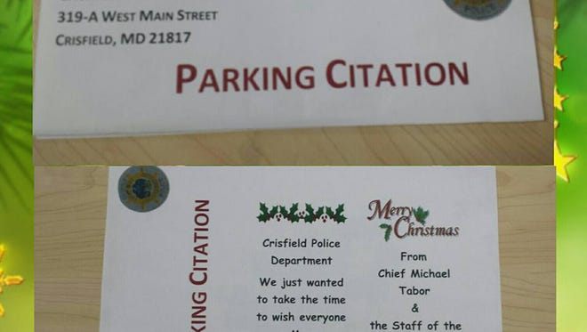 "The Crisfield Police Department's holiday cheer ""parking citation"" is shown."