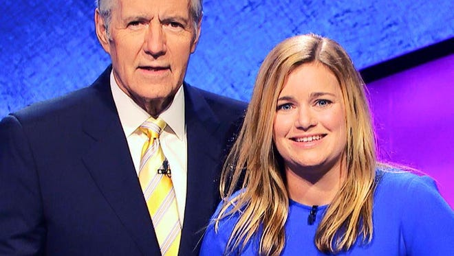 Demi Hueth (right) stands next to Jeopardy host Alex Trebek. Hueth was a Jan. 22 contestant on ABC's nationally televised quiz game show.