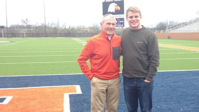 Rosman senior Tanner Green and former Tigers football coach Jim Fox.