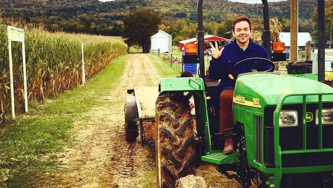 Jackson Vaught works on the family farm in Milton.