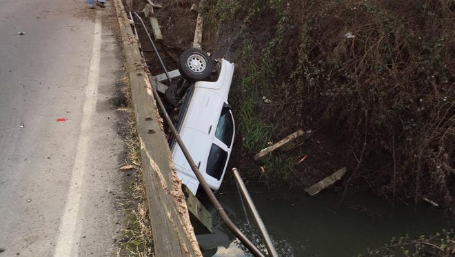Mt. Angel Fire District crews responded to a crash that left a pickup truck in a creek draining into the Pudding River Friday morning.